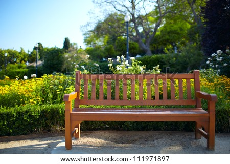 Bench in the park in Barcelona. Warm colors. Color corrected in LAB. - stock photo