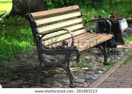 bench in the park in spring - stock photo