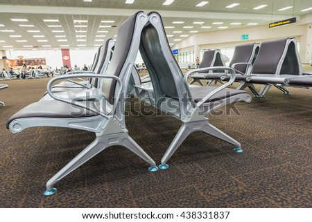 Bench in the terminal of airport , waiting area with chairs. - stock photo