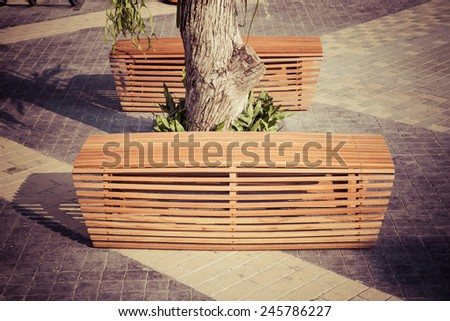 Bench modern design in garden - stock photo