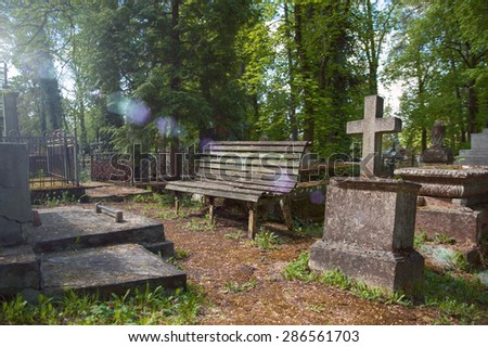 bench on an old cemetery - stock photo
