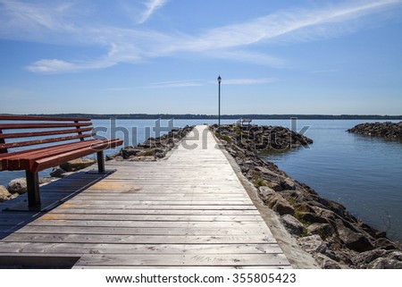 bench on little canadian jetty - stock photo