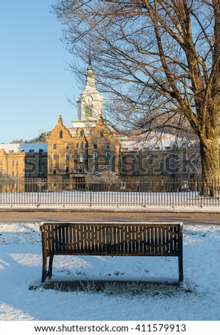 Bench outside Trans-Allegheny Lunatic Asylum which is a Kirkbride Psychiatric hospital  in Weston, West Virginia, USA - stock photo