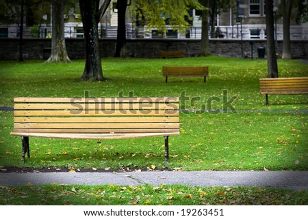 Bench park in autumn - stock photo