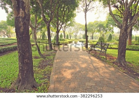 Bench under the tree in the Gardens, vintage style - stock photo