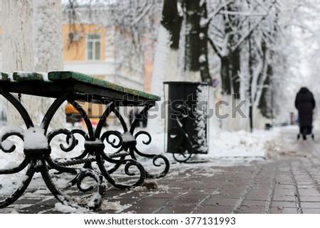 bench winter sidewalk - stock photo