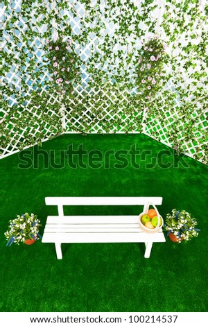 Bench with an arbor in the garden - stock photo