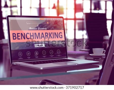 Benchmarking Concept Closeup on Laptop Screen in Modern Office Workplace. Toned Image with Selective Focus. 3d Render. - stock photo