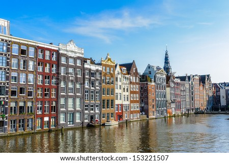 Bend buildings over the river Amstel in Amsterdam, Netherland - stock photo
