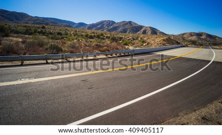 Bend in a road through the desert of the American southwest. - stock photo