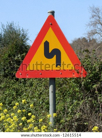 Bend in the road Greek european signpost - stock photo