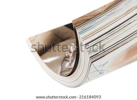 bended magazine isolated on white - stock photo