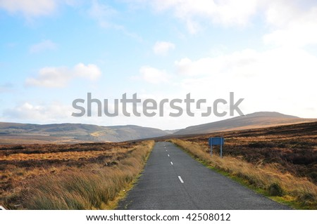 Bending Road through the Wicklow Mountains - stock photo