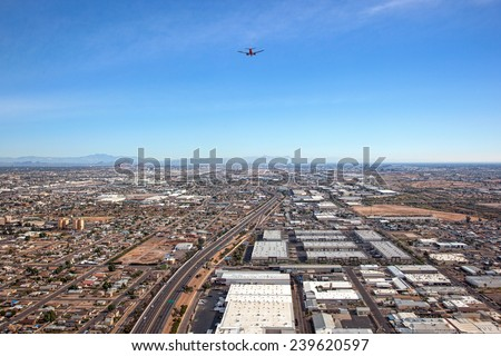 Beneath a commercial jet airliner on it's approach to Sky Harbor International Airport in Phoenix, Arizona - stock photo
