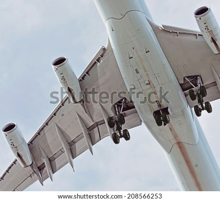 beneath an airplane in the sky - stock photo