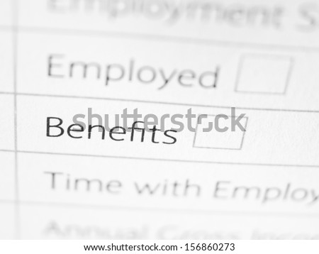 BENEFITS printed on a form close up - stock photo