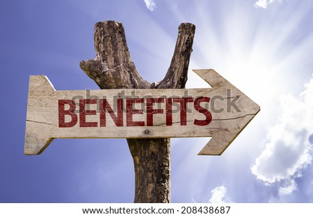 Benefits wooden sign on a beautiful day - stock photo