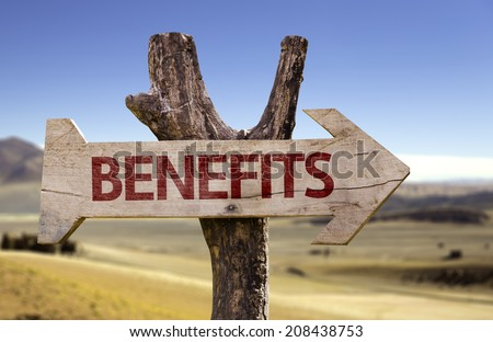 Benefits wooden sign on desert background - stock photo
