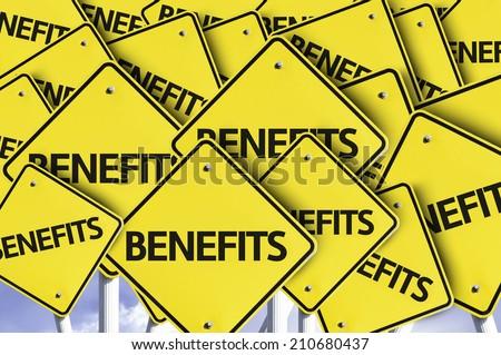 Benefits written on multiple road sign  - stock photo