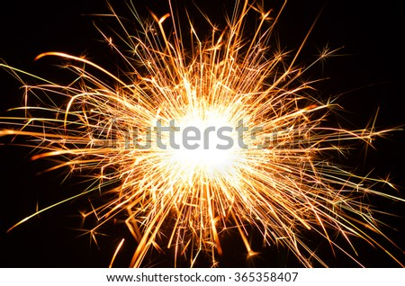 Bengal fire sparks on black background - stock photo