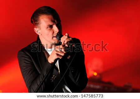 BENICASIM, SPAIN - JULY 18: Theo Hutchcraft, singer of Hurts (band), performs at FIB (Festival Internacional de Benicassim) 2013 Festival on July 18, 2013 in Benicasim, Spain. - stock photo