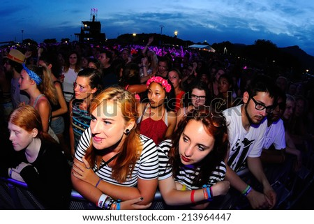 BENICASSIM, SPAIN - JULY 20: Audience in a party at FIB Festival on July 20, 2014 in Benicassim, Spain. - stock photo