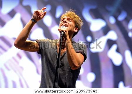 BENICASSIM, SPAIN - JULY 20: Paolo Nutini (Scottish singer, songwriter and musician) performs at FIB Festival on July 20, 2014 in Benicassim, Spain. - stock photo