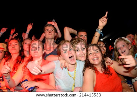 BENICASSIM, SPAIN - JULY 20: Women from the crowd at FIB Festival on July 20, 2014 in Benicassim, Spain. - stock photo