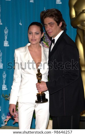 BENICIO DEL TORO, winner of Best Supporting Actor, with actress ANGELINA JOLIE at the 73rd Annual Academy Awards in Los Angeles. 25MAR2001.   Paul Smith/Featureflash - stock photo
