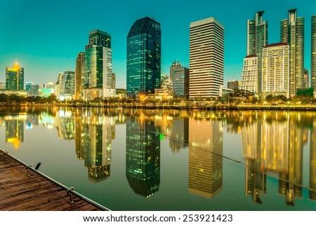 Benjakitti park Bangkok downtown city in evening twilight, Thailand - stock photo
