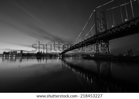 Benjamin Franklin Bridge after sunset from new jersey side. - stock photo