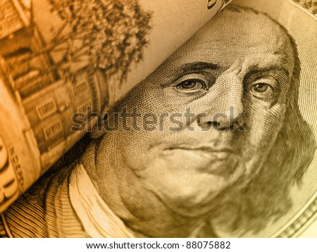 Benjamin Franklin on a  $100 bill in gold tones. - stock photo