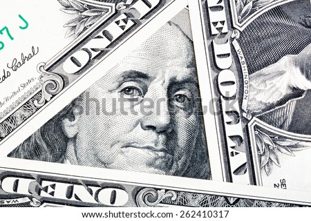 Benjamin Franklin on the one hundred dollar bill framed by other banknotes - stock photo