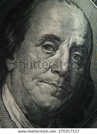 Benjamin Franklin's portrait is depicted on the $ 100 banknotes. Close up - stock photo