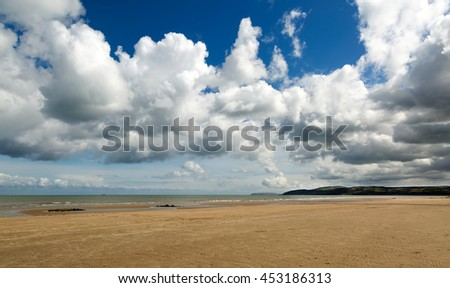 Bennlech beach at low tide in Anglesey - stock photo