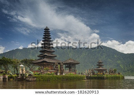 Beratan Lake. Bali, Indonesia. This temple is known as Ulun Danu. Ulun means heart, Danu means lake. This Temple is dedicated to the Goddess of the lake. A very famous tourist destination in Bali. - stock photo
