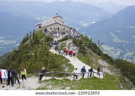 """BERCHTESGADEN,GERMA NY, JUNE 14, 2013: Tourists visit Kehlsteinhaus in Obersalzberg. The """"Eagle's Nest"""" was built for Adolph Hitler for his 50th birthday. Located at an altitude of 1834 m asl - stock photo"""