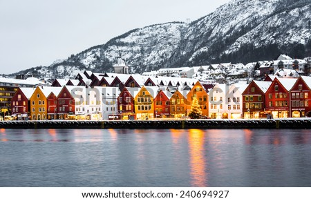 Bergen, Norway - December 29, 2014: Famous Bryggen street with wooden colored houses in Bergen at Christmas, Norway - stock photo