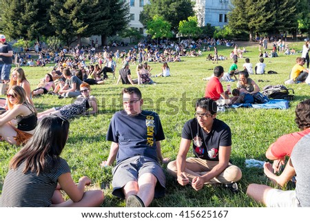 BERKELEY, CA- Apr 16, 2016: Crowds of students at the University of California Berkeley outdoors on the open green grassy space called Memorial Glade, on Cal Day, the annual campus-wide open house. - stock photo