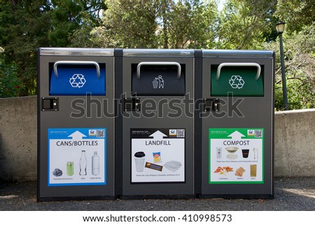 Berkeley, CA - April 24, 2016: Recycling, Landfill and Compost garbage bins on UC Berkeley campus. University of California Berkeley is involved in many innovative projects aimed at reducing waste. - stock photo