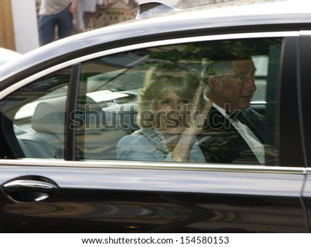 BERLIN-APRIL 29, 2009: Camilla Parker Bolwes and Prince Charles leave the Hotel Adlon in Berlin Mitte during a journey through Germany by the British Crown Prince and his wife. - stock photo