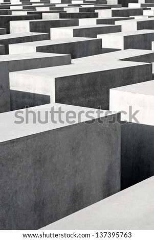 BERLIN - AUGUST 19: Close up detail of the concrete blocks that make up the public Memorial to the Murdered Jews of Europe on August 19, 2010 in Berlin. - stock photo