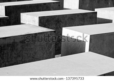 BERLIN - AUGUST 19: Close-up view on the Holocaust Memorial on August 19, 2010 in Berlin. There are 2,711 concrete blocks. It reminds on the murdered Jews of Europe. - stock photo