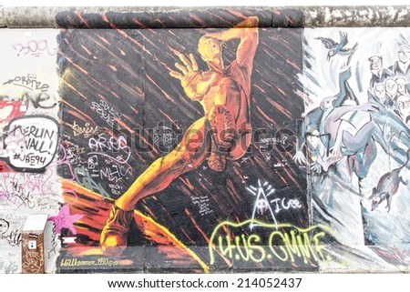 BERLIN - AUGUST 24, 2014 : The East Side Gallery is the largest outdoor art gallery in the world. This is a graffiti of the brotherly kiss of former politicians  Breschnew and Honecker. - stock photo