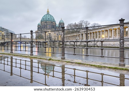 Berlin Cathedral (Berliner Dom) and Museum Island (Museumsinsel) reflected in puddle, Berlin, Germany, Europe - stock photo