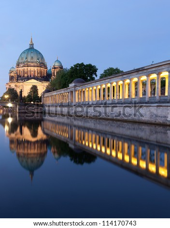 Berlin Cathedral (Berliner Dom) panorama reflection, famous landmark in Berlin City, Germany at night - stock photo