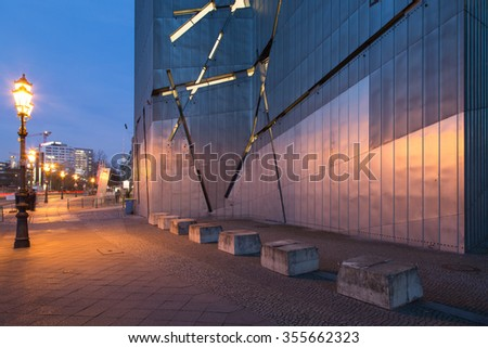 BERLIN - December 03 2013 : Architectural detail of the facade of the Jewish Museum in Berlin, Germany. Daniel Libeskind designed this landmark of deconstructivist architecture. - stock photo