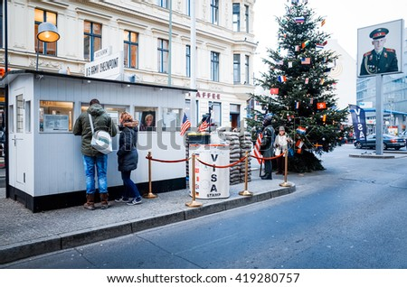 BERLIN, 4 December: Checkpoint Charlie. Former bordercross in Berlin on 4 December, 2014. Berlin Wall crossing point between East and West Berlin during the Cold War. BERLIN, GERMANY - stock photo