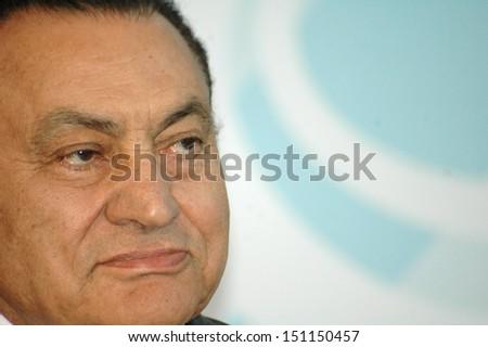BERLIN - DECEMBER 10: Egyptian President Hosni Mubarak during a meeting with the German Chancellor in the German Chanclery in Berlin, December 10, 2006. - stock photo