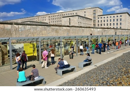 """BERLIN, GERMANY - APRIL 30, 2014: Tourists in the """"Topography of Terror"""" an open-door museum, place during the Nazi regime was the headquarter of the Gestapo and the SS, on April 30, 2014 in Berlin. - stock photo"""